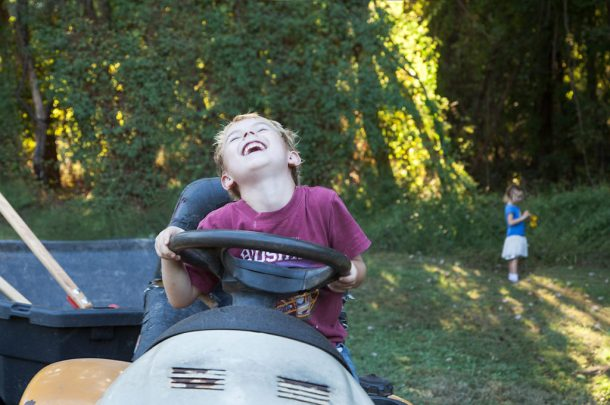 lise-metzger-mason-laughing-on-tractor